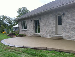 Hortons Concrete patio with stamped and stained border